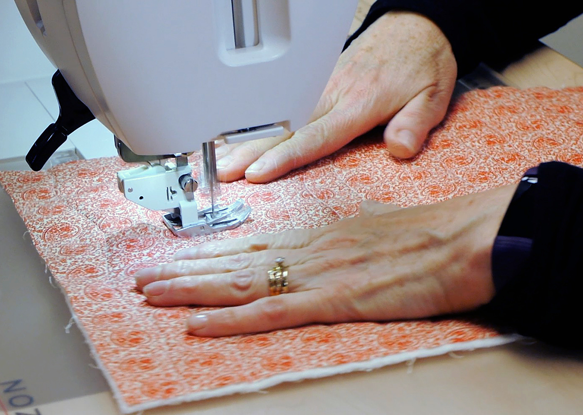 Quilting the top and batting with the Janome Horizon Memory Craft 9400 QCP's amazing walking foot with AcuFeed Flex system