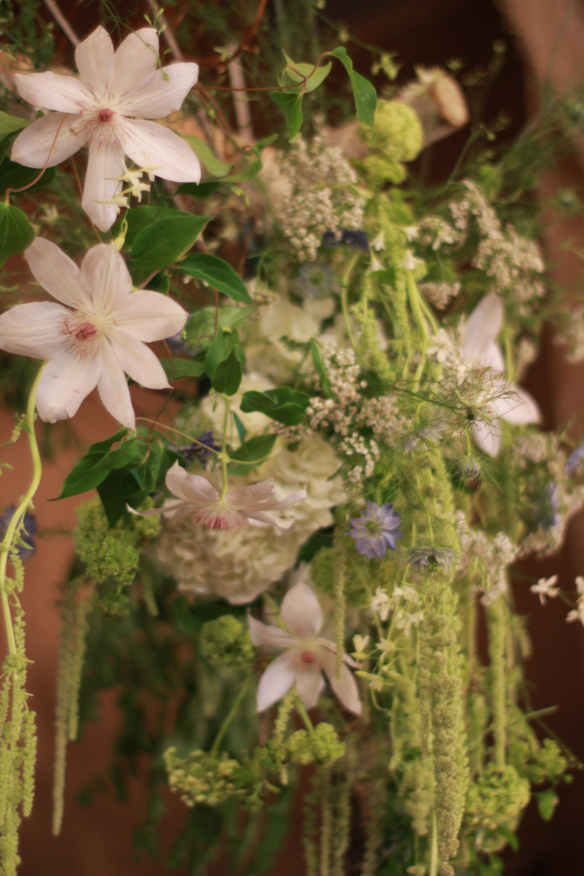 Some of the gorgeous materials used on the arbor: clematis, hanging amaranth, yarrow, nigella, viburnum, hydrangea, and more…