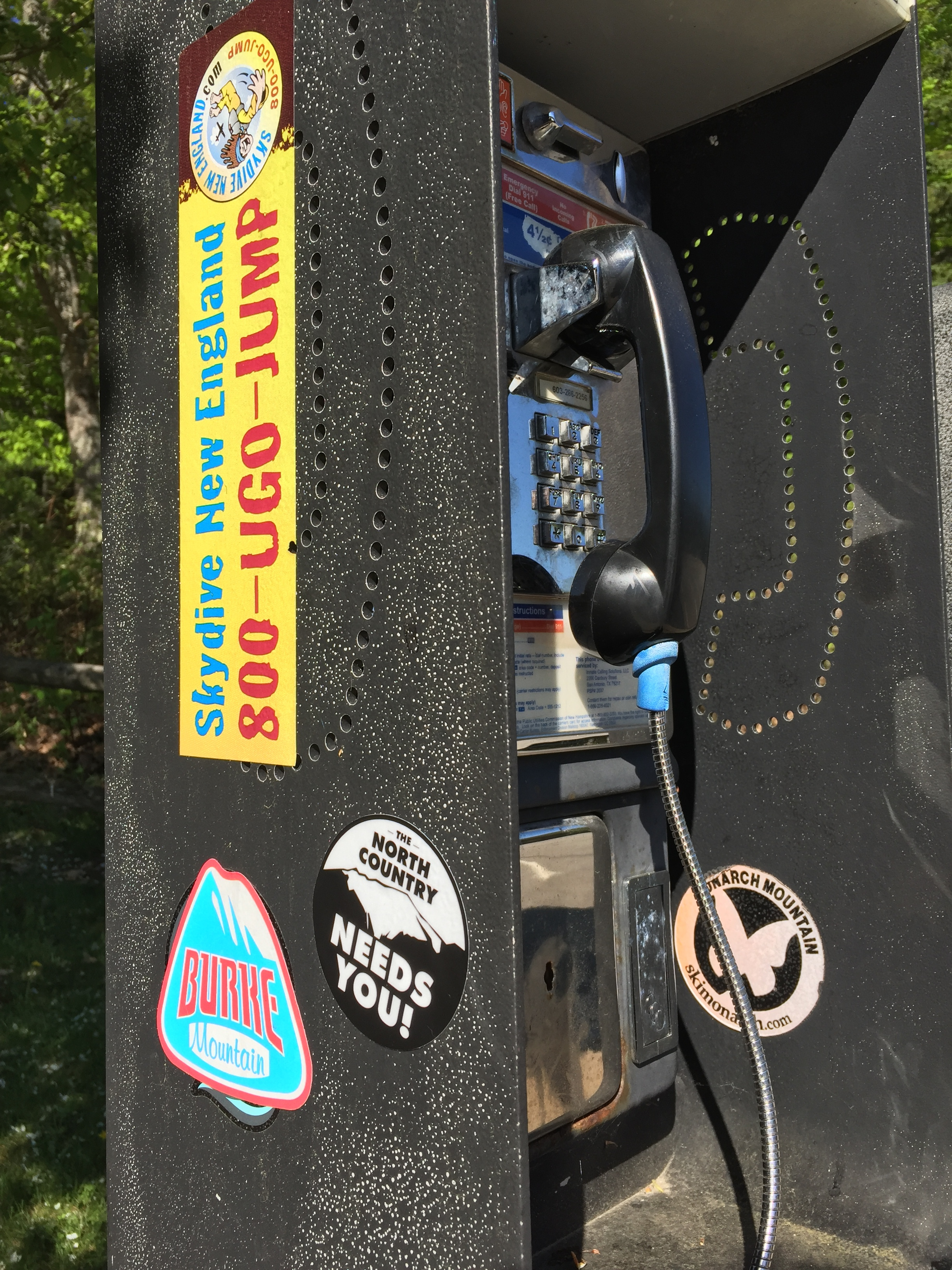 """I can't resist a pay phone to slap a sticker on. Good thing I had a """"The North Country Needs You"""" sticker on hand at the rest stop on 93S"""