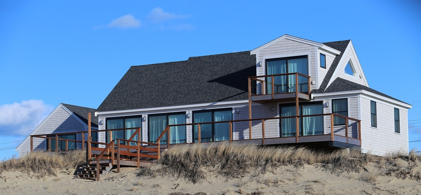 Ambrose Homes lifted and renovated this Eastham residence on Cape Cod bay,