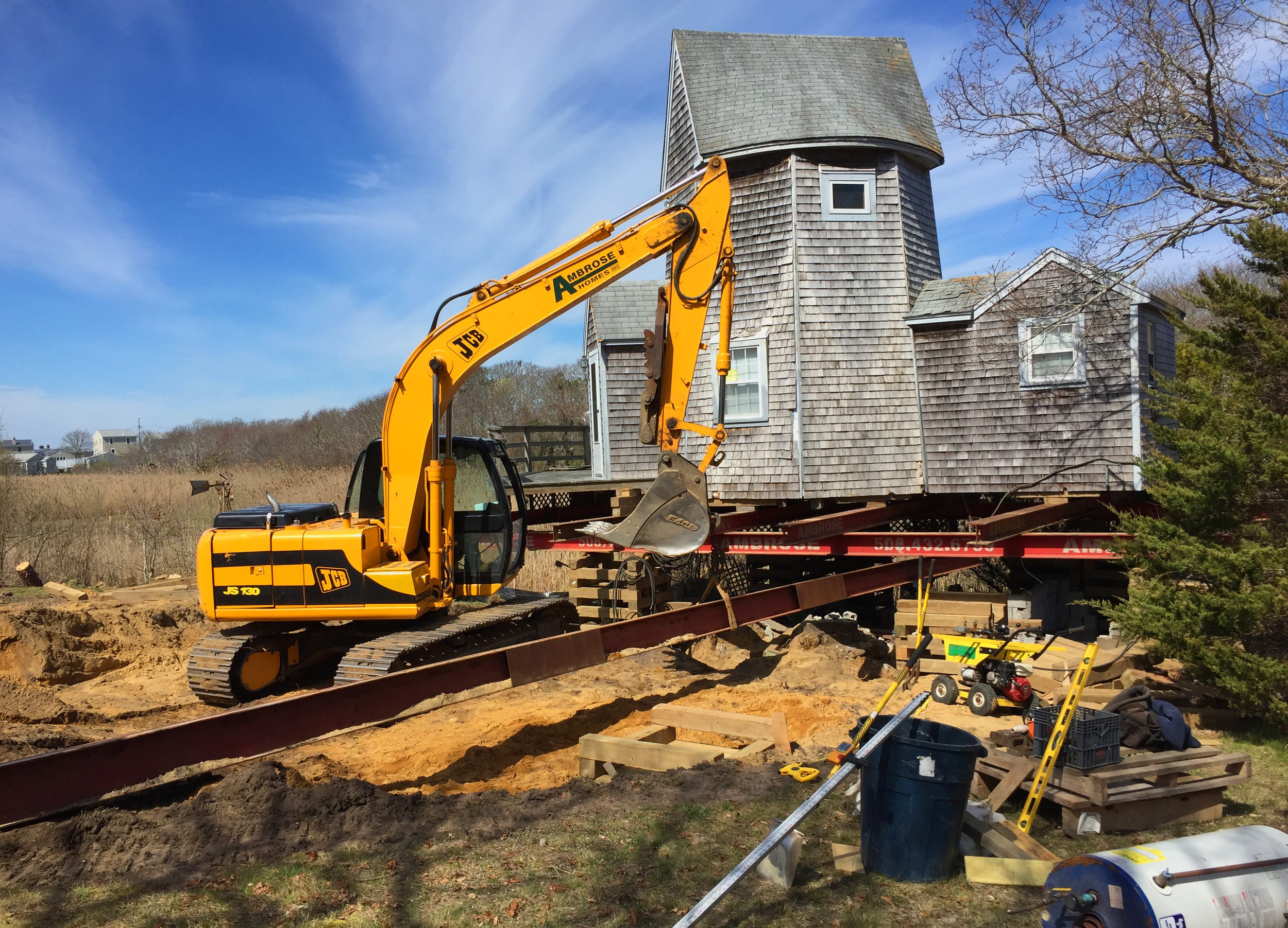 historic home lifted and moved to protect from flood waters