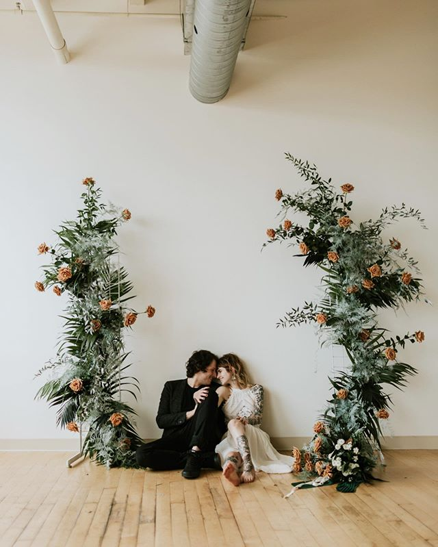 Still dying over this shoot. Huge thanks to my friend Heather @fairrarityflowers for creating some of the coolest floral designs I've ever seen. One of the best in the business hands down! Another big thanks to my new friends @blondeyed_and_badass and @selkeysmooth for being madly in love with each other and killing it in front of the camera! I will forever be posting from this session ❤️ // Photographer: @lahuddphoto Florals:  @fairrarityflowers Dress: BabyDoll Shop  Suit Jacket:  @asos Grooms Pants: @pacsun Grooms Shoes: @vans Bride's Ring: Bella Design Jewelers  Grooms Ring: Etsy  Cake: @thebepper Venue: @suite226cleveland Hair + Makeup: @willow_studio_13