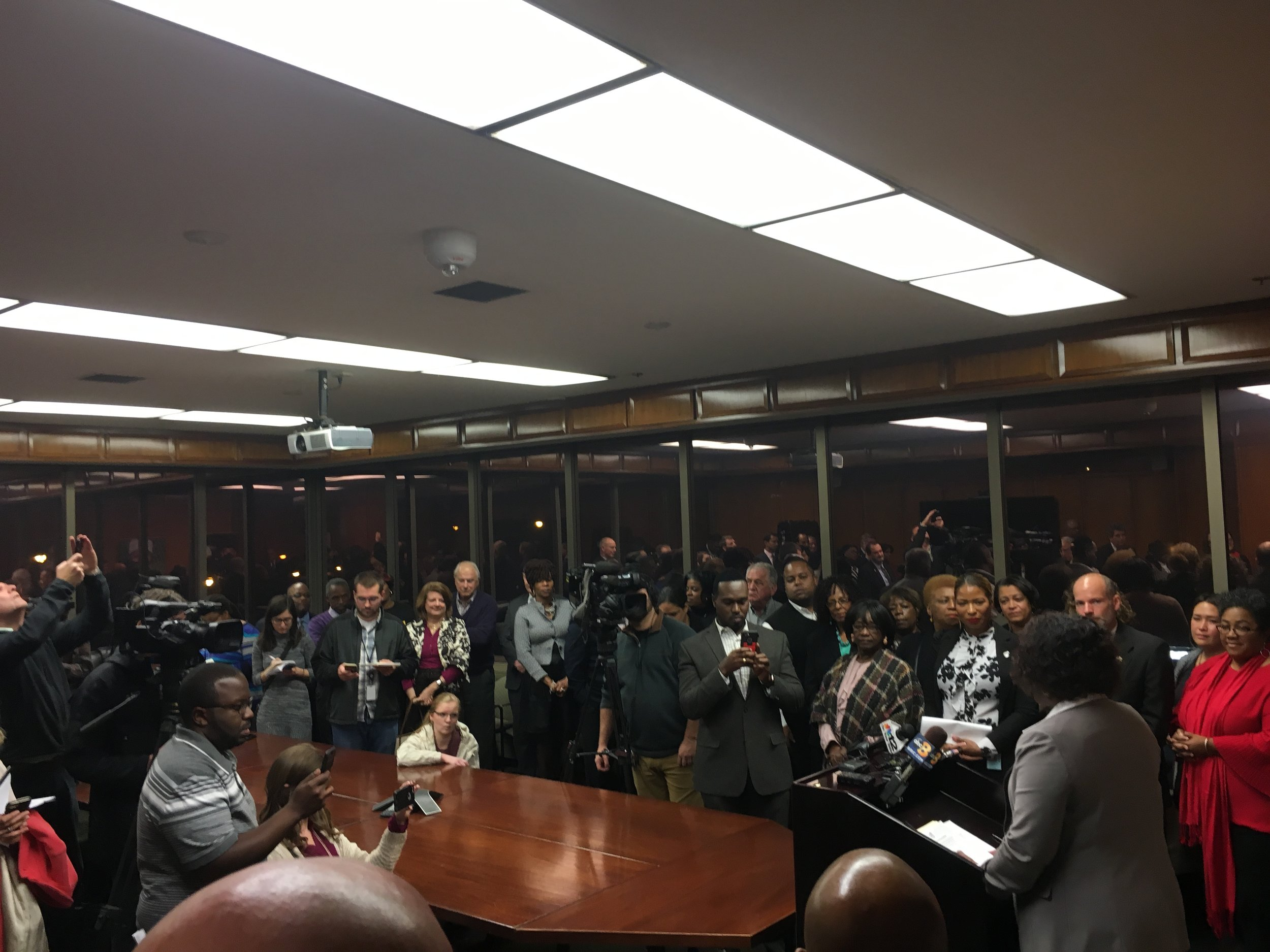 Crowded conference room announcing Jason Kamras as new Superintendent (self-taken)