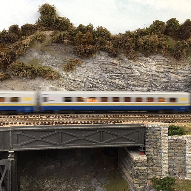 Speed! VIA wooshes by along the Ridge. #modeltrain #modeltrains #modelrailroading #modelrailroad #modelrailway #modelrailways #viarail #hoscale #hoscaletrains #garfieldcentralrailroad