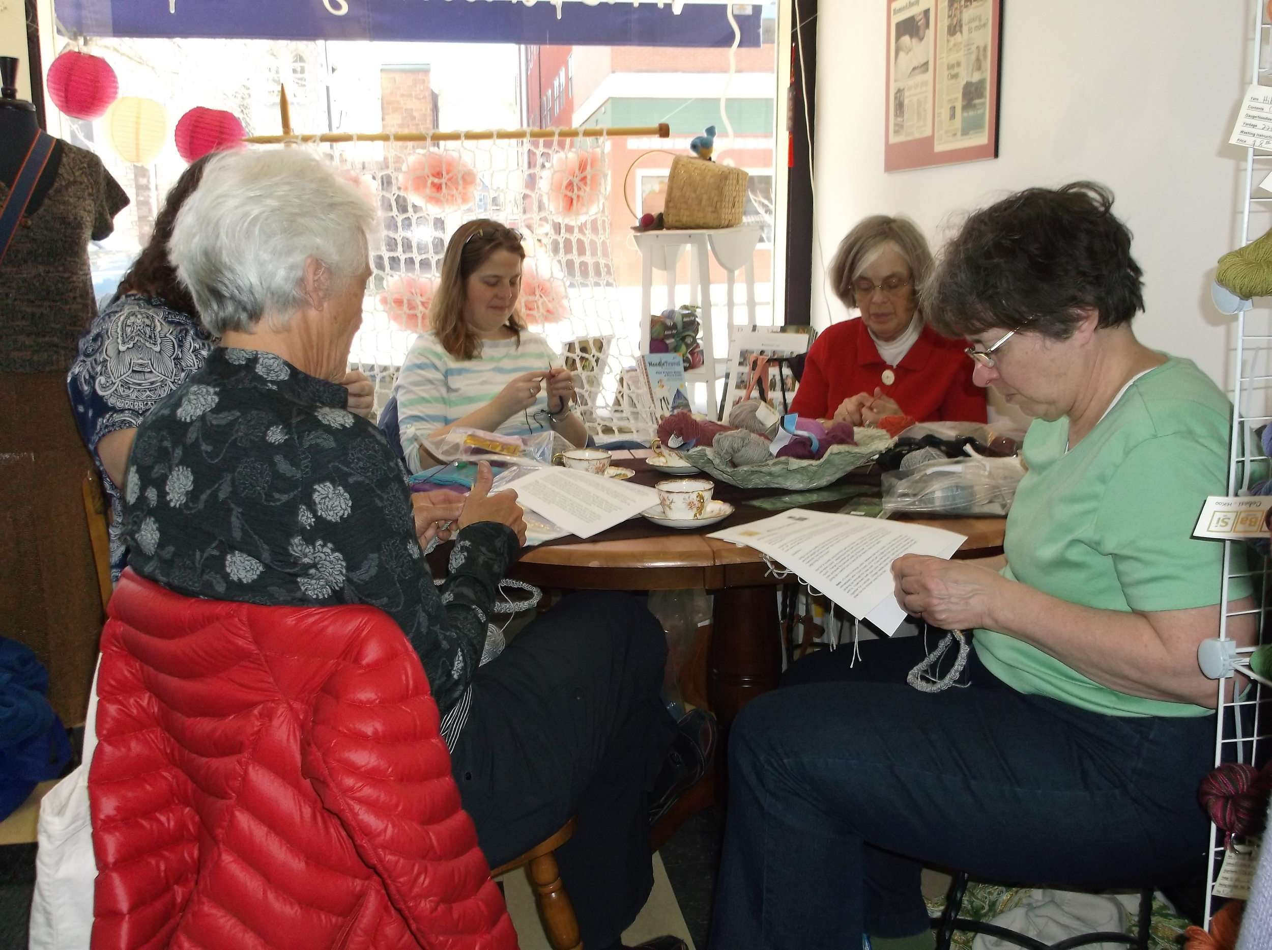 Women enjoy creative and social time at one of yarn's classes