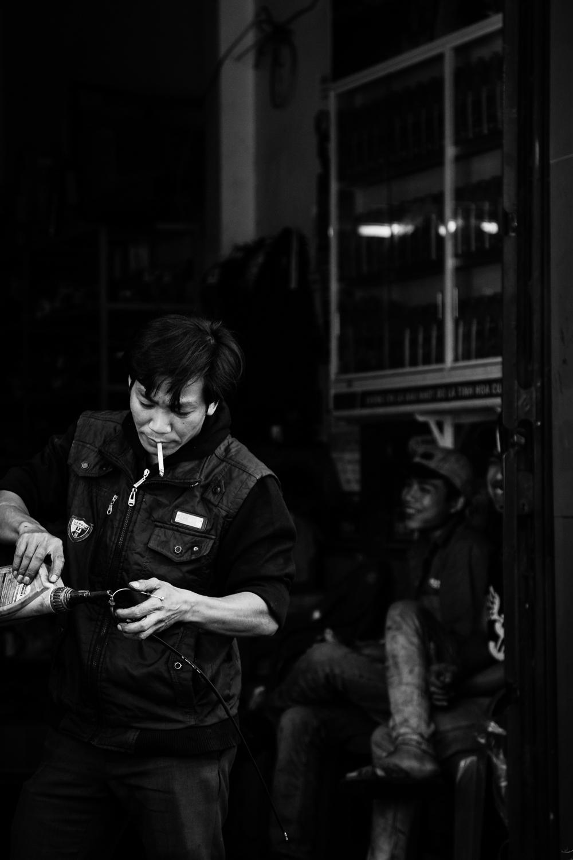 adventure-photography-motorcycle-vietnam-becky-brockie-mechanic.jpg