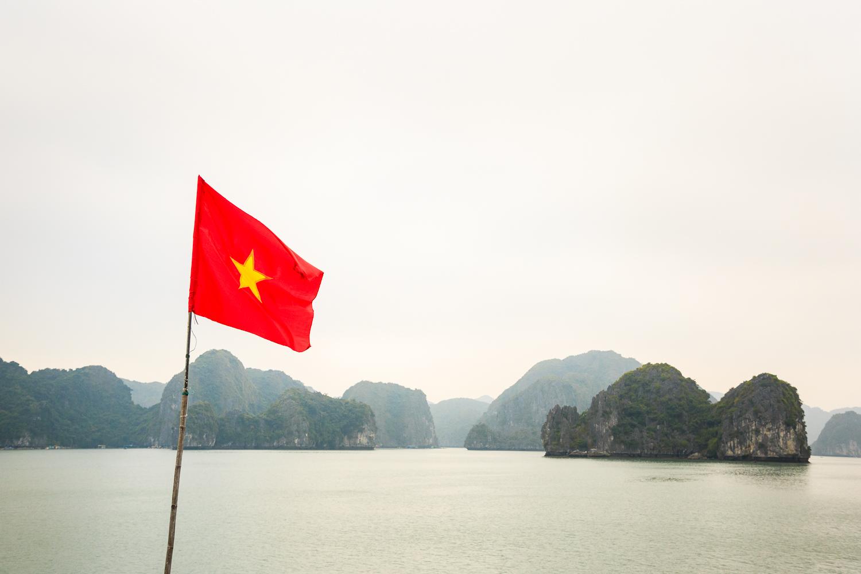 adventure-photography-motorcycle-vietnam-becky-brockie-halong-vietnam-flag.jpg