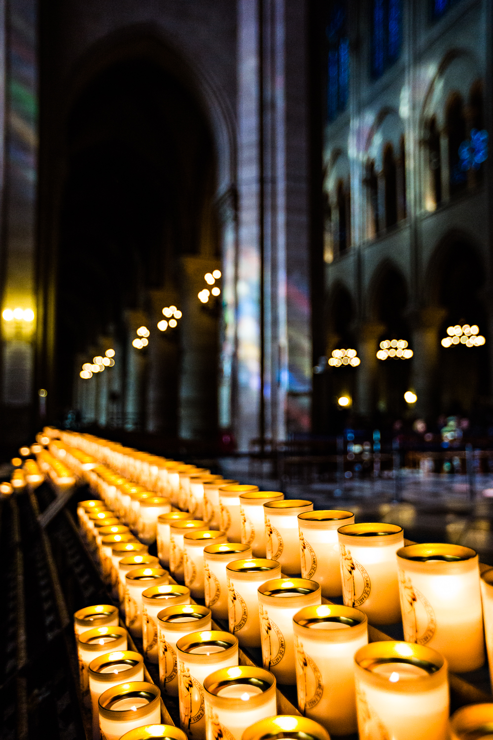 adventure-travel-photography-becky-brockie-paris-notre-dame-candles.jpg