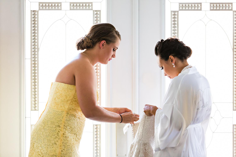 billings-montana-chanceys-wedding-bridesmaid-helps-bride.jpg