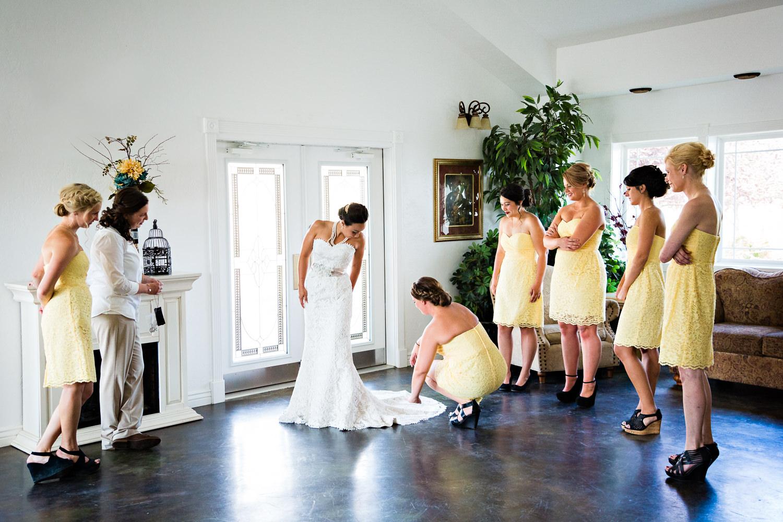 billings-montana-chanceys-wedding-bridesmaids-straighten-dress.jpg