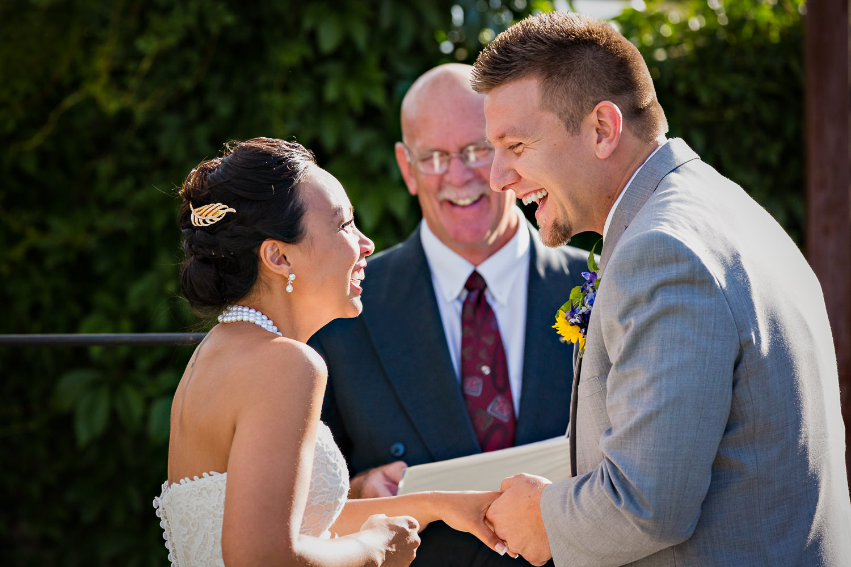 billings-montana-chanceys-wedding-ceremony-groom-bride-laughing.jpg