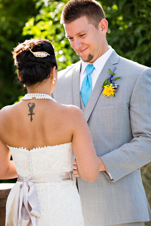 billings-montana-chanceys-wedding-ceremony-groom-smiles-at-bride.jpg