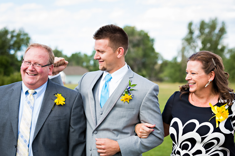 billings-montana-chanceys-wedding-ceremony-groom-parents.jpg