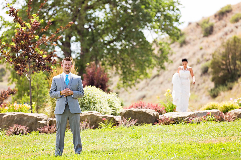 billings-montana-chanceys-wedding-first-look-bride-approaches-groom.jpg