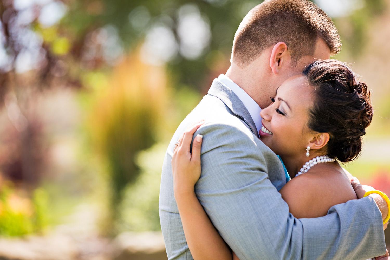 billings-montana-chanceys-wedding-first-look-bride-groom-embrace.jpg