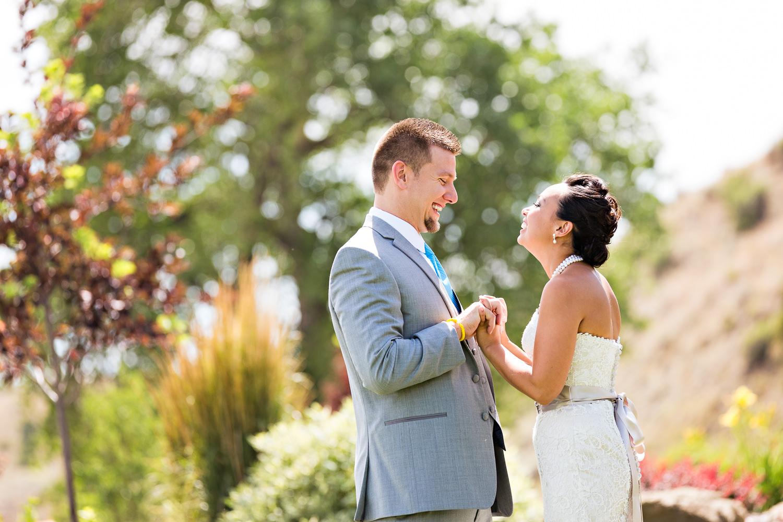billings-montana-chanceys-wedding-first-look-bride-groom-holding-hands.jpg