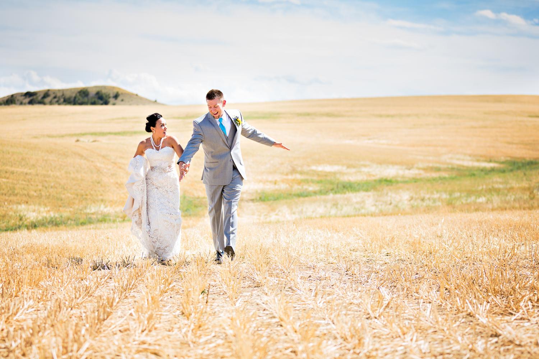 billings-montana-chanceys-wedding-first-look-bride-groom-running-away.jpg