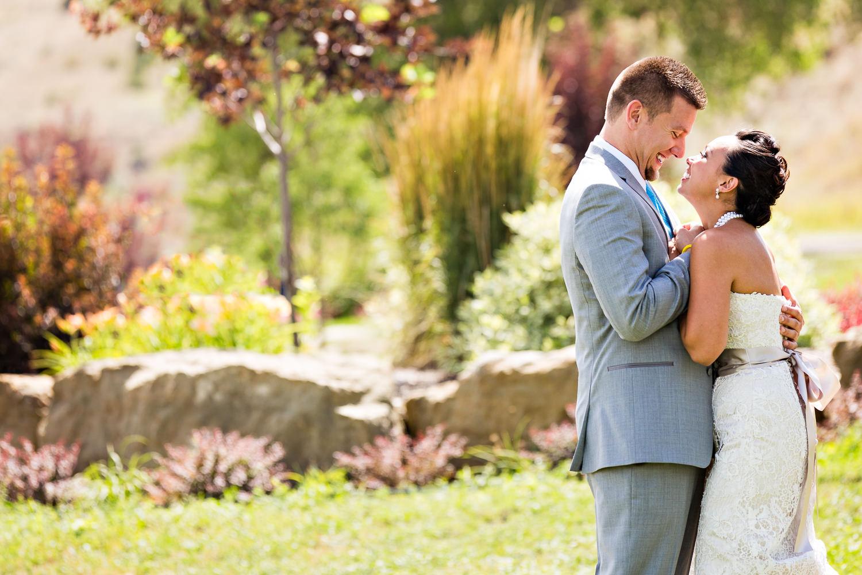 billings-montana-chanceys-wedding-first-look-groom-hugs-bride.jpg