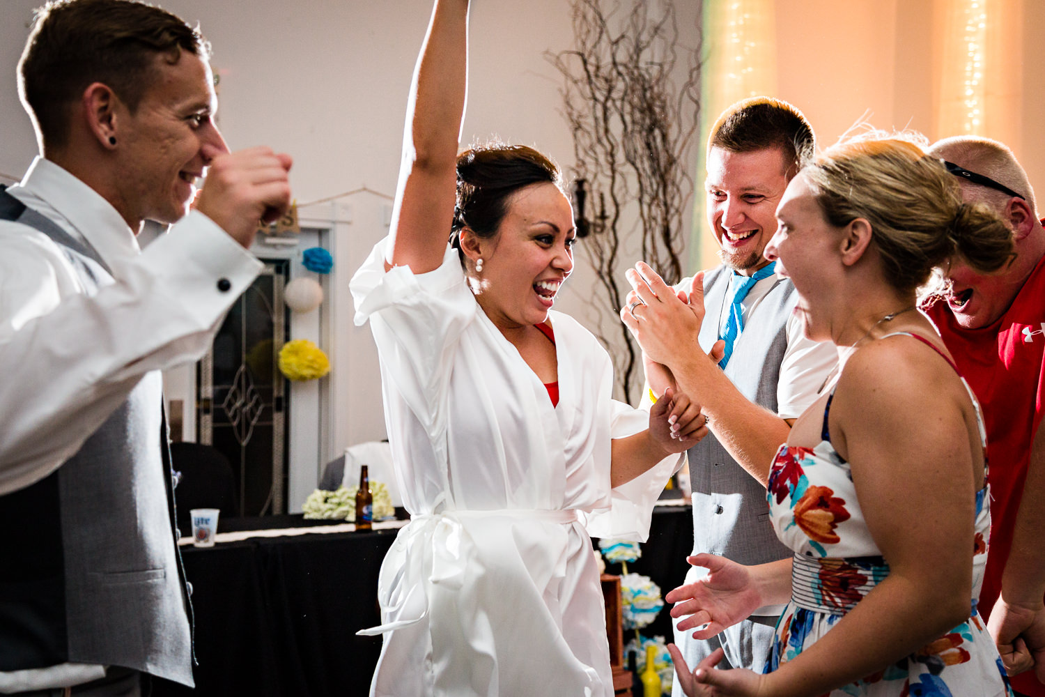 billings-montana-chanceys-wedding-reception-bride-laughing-with-guests.jpg