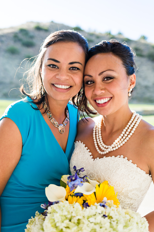 billings-montana-chanceys-wedding-reception-bride-hugs-sister.jpg