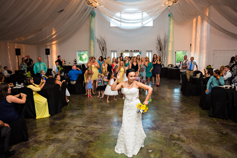 billings-montana-chanceys-wedding-reception-bride-tosses-bouquet.jpg