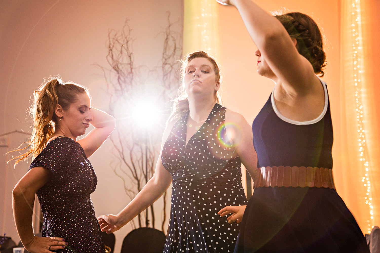 billings-montana-chanceys-wedding-reception-female-guests-dance-together.jpg