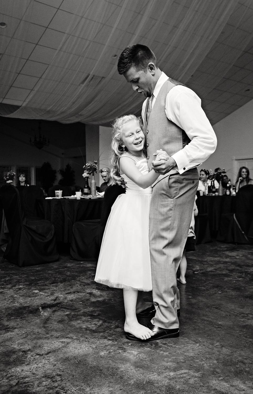 billings-montana-chanceys-wedding-reception-groom-dancing-with-baby-sister.jpg
