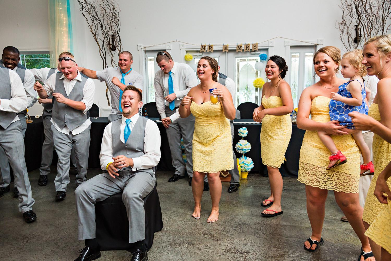 billings-montana-chanceys-wedding-reception-groom-laughing-during-bride-performance.jpg