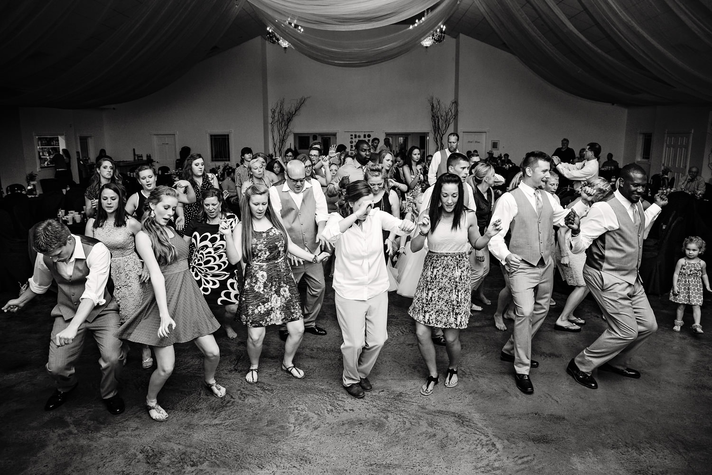billings-montana-chanceys-wedding-reception-guests-dance-together.jpg