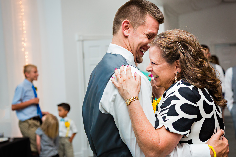 billings-montana-chanceys-wedding-reception-mother-son-dance-hug.jpg