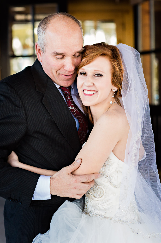 big-sky-montana-winter-wedding-breanna-father-first-look-bride-hugs-dad.jpg
