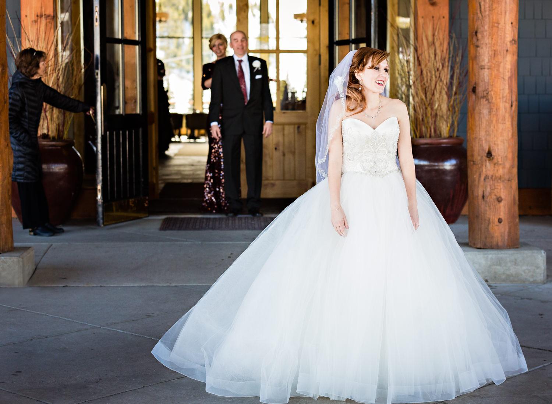 big-sky-montana-winter-wedding-breanna-father-first-look-bride-smiling.jpg