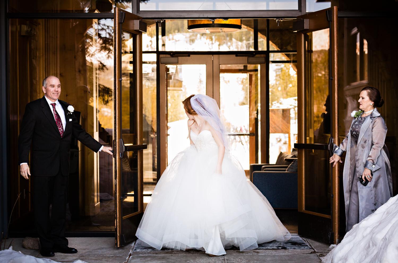 big-sky-montana-winter-wedding-breanna-first-look-parents-hold-door.jpg