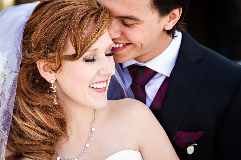 big-sky-montana-winter-wedding-breanna-first-look-groom-whispers-to-bride.jpg
