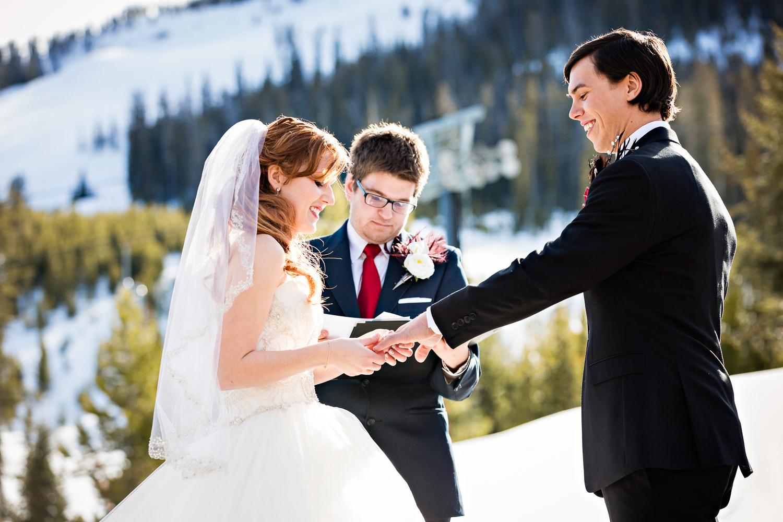 big-sky-montana-winter-wedding-breanna-ceremony-bride-exchanges-rings.jpg