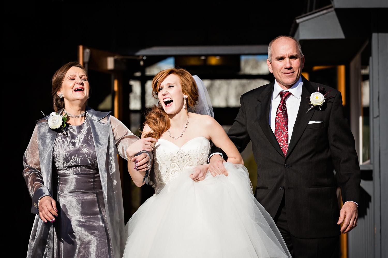 big-sky-montana-winter-wedding-breanna-ceremony-bride-laughing-with-parents.jpg