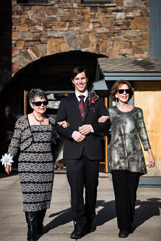 big-sky-montana-winter-wedding-breanna-ceremony-groom-escorts-grandmas.jpg