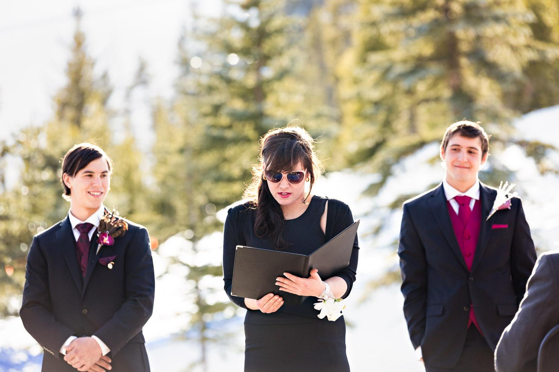 big-sky-montana-winter-wedding-breanna-ceremony-sister-reading.jpg