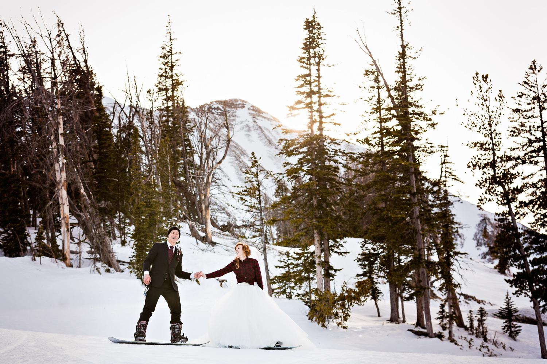 big-sky-montana-winter-wedding-breanna-formals-bride-groom-holding-hands.jpg