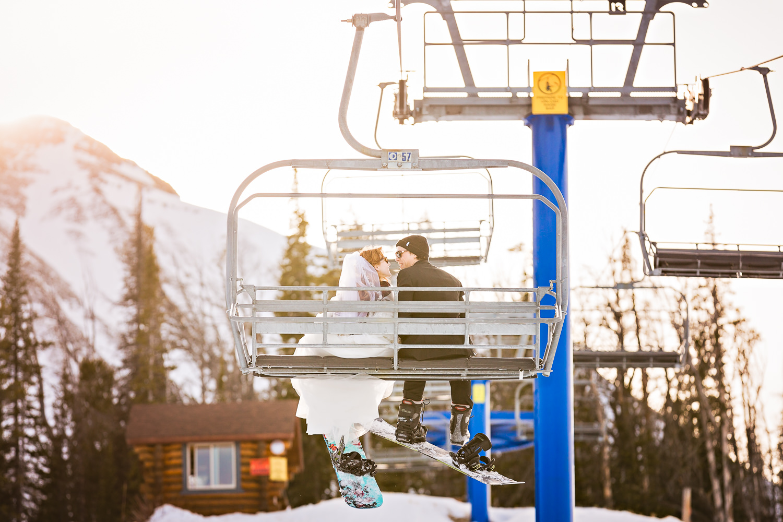 big-sky-montana-winter-wedding-breanna-formals-bride-groom-ride-chairlift.jpg