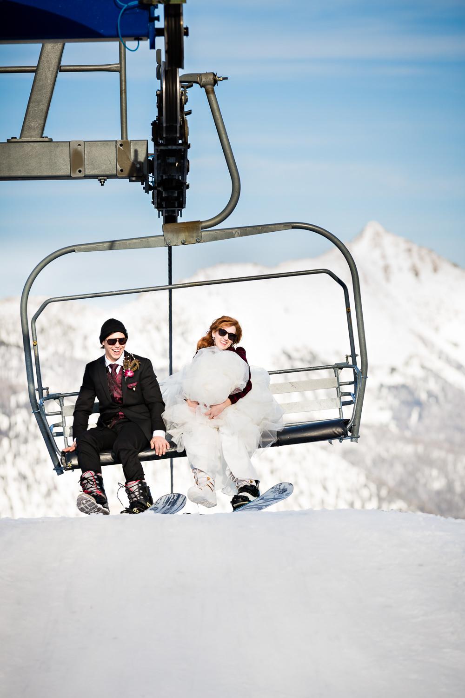 big-sky-montana-winter-wedding-breanna-formals-bride-groom-unload-chairlift.jpg