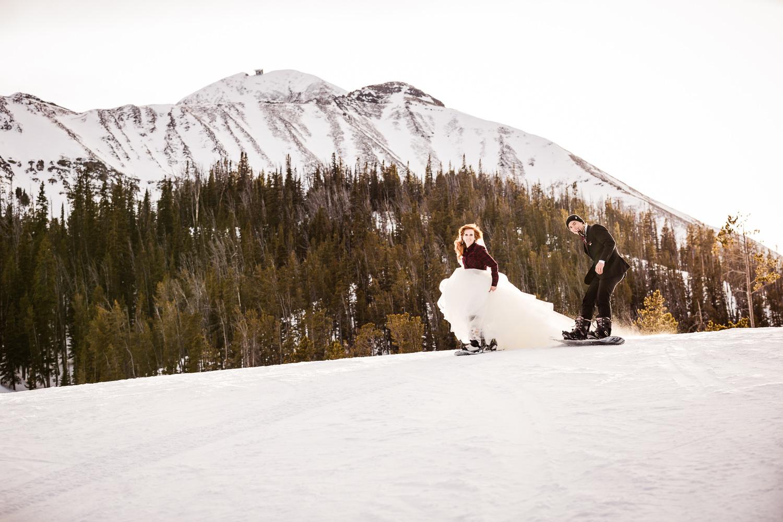 big-sky-montana-winter-wedding-breanna-formals-bride-groom-snowboarding.jpg