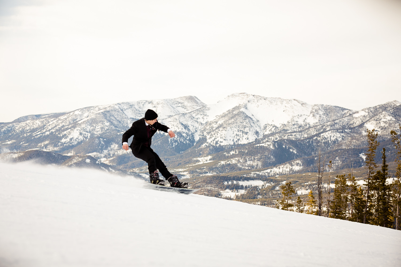 big-sky-montana-winter-wedding-breanna-formals-groom-snowboarding.jpg