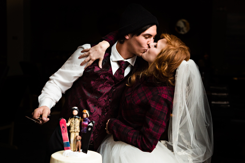 big-sky-montana-winter-wedding-breanna-reception-bride-groom-cut-cake.jpg