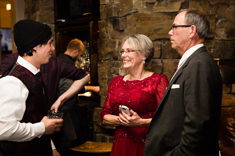 big-sky-montana-winter-wedding-breanna-reception-groom-visits-parents.jpg
