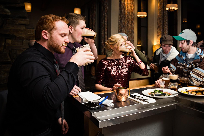 big-sky-montana-winter-wedding-breanna-reception-guests-drink.jpg