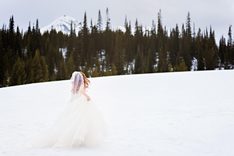 big-sky-montana-winter-wedding-breanna-first-look-bride-in-snowy-scene.jpg