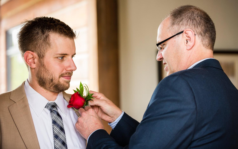 big-sky-wedding-becky-brockie-photography-dad-groom-flower.jpg