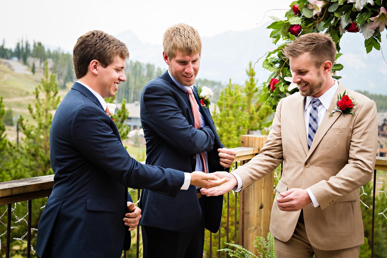 big-sky-wedding-becky-brockie-photography-wedding-find-rings.jpg