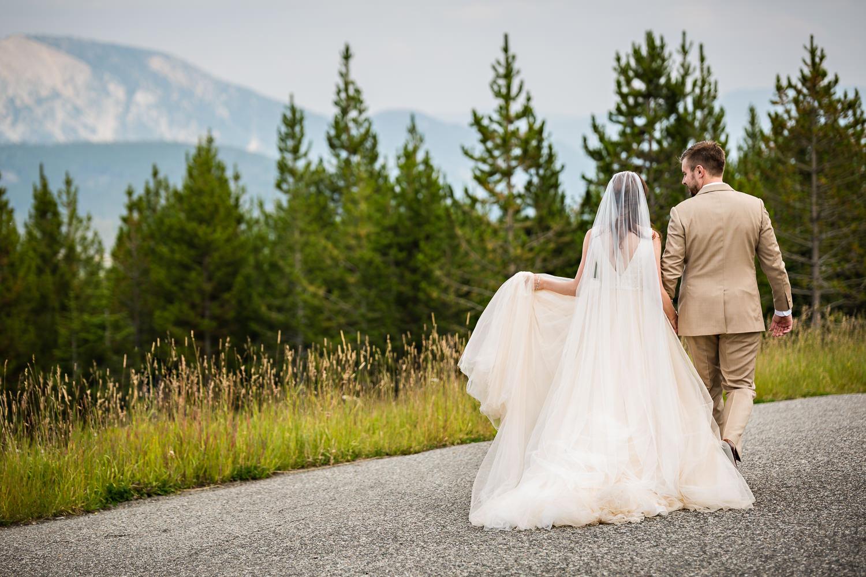 big-sky-wedding-becky-brockie-photography-couple-walk-mountains.jpg